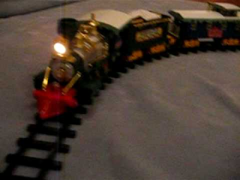NorthPole Christmas Express Animated Train Set Plays Christmas Carols with  Santa Claus, Reindeer, and Elves on Hand Car