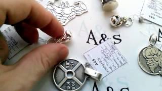 Обзор серебряных спортивных кулонов.