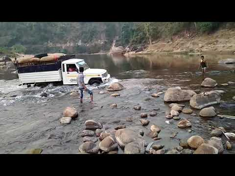 Mahindra bolero pick up fully loaded through rocky river|Stuck in the middle !! but comes out !!