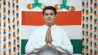 Indian man join hands for the greeting (namaste position) facing towards the camera - Independence Day