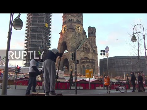 Germany: Muslim volunteers clean up on Berlin's Breitscheidplatz after NYE celebrations
