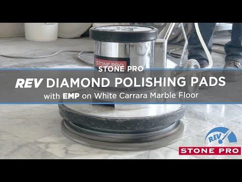 StonePro REV Diamond Polishing Pads on White Carrara Marble Floor