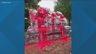 KKkonfederate symbols destroyed by protestors in Atlanta