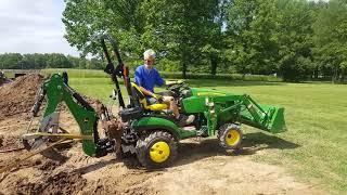 John Deere 1025R & Bxpanded ripper take on monster stump