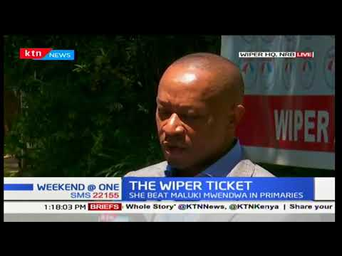 Wiper party hands the nomination certificate to the winner of the Wiper ticket Edith Nyenze