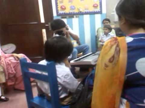 Mahad singing poem with the music teacher in lacas.3gp
