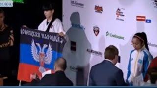 Украина в шоке_На пьедестале почета флаг ДНР