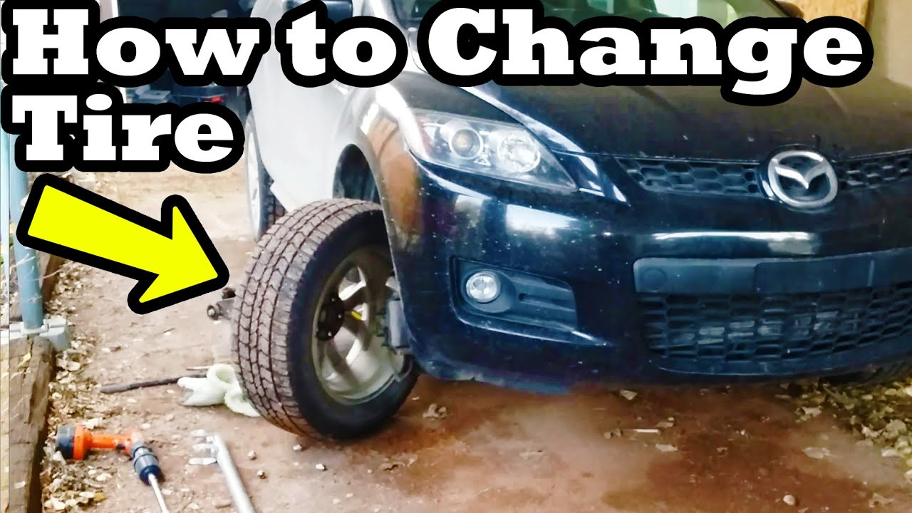 how to change a tire change a flat car tire step by step youtube. Black Bedroom Furniture Sets. Home Design Ideas