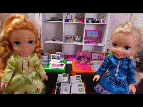 Elsa and Anna toddlers at the mall shopping at Barbie's shop
