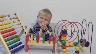 Икеа игрушки: мула счеты, лабиринт, головоломка, колышки и молоток.