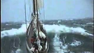 Sailingyacht between big waves sailing