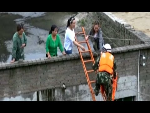China: People evacuated after devastating floods destroy thousands of homes