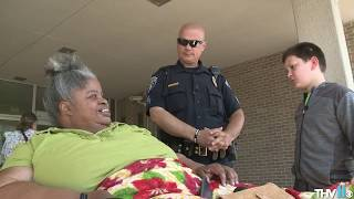 Officer Tommy Norman takes foster child on daily routine