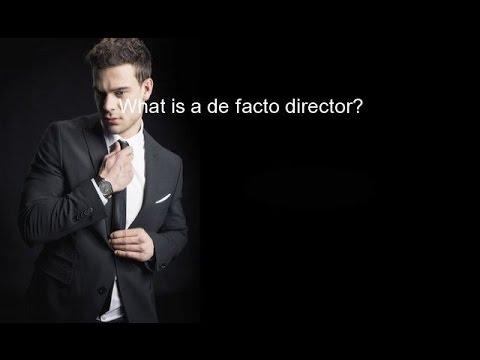What is a de facto director?