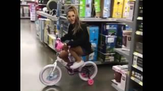 Ariana Grande riding a bike in the store😂