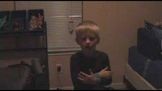 Kid singing Britney Spears scared to death by his mom