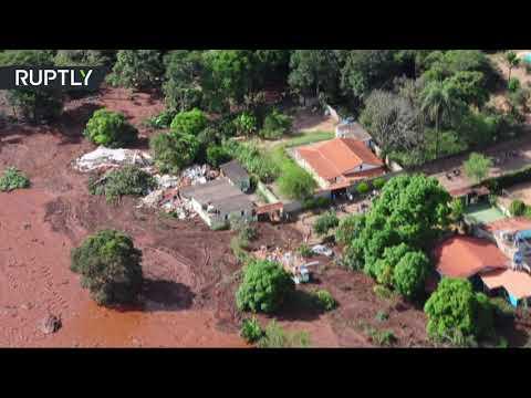 Deadly dam collapse: Hundreds missing after torrent of sludge bursts out in Brazil