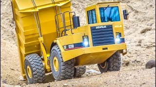 BRAND NEW  CATERPILLAR D25D dump truck gets dirty!