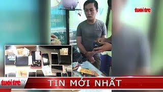 10. Cảnh sát tóm gọn kẻ trộm tài sản hàng chục người trong công viên nước Đầm Sen