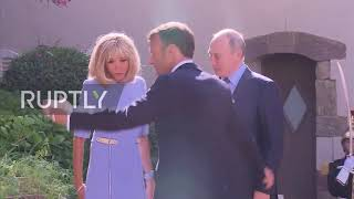 Putin hands injured Brigitte Macron flowers at talks