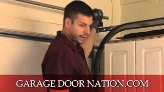 how to fix a crooked garage door
