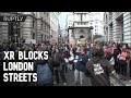 Extinction Rebellion block London streets as protest marks 7th day