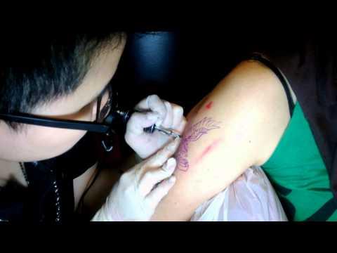 Mom getting tattooed by Tommy Seow of FAMILIAR STRANGERS Tattoo Studio, Singapore