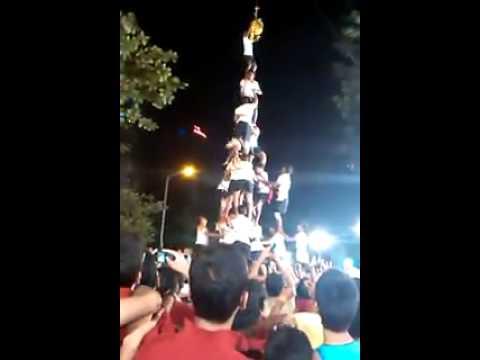 Guy hanging with no pants after human pyramid fail