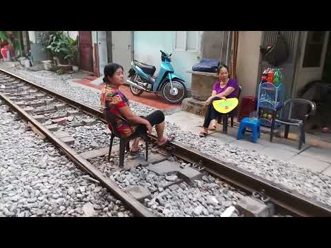 Earn living right on the train track in Hanoi.