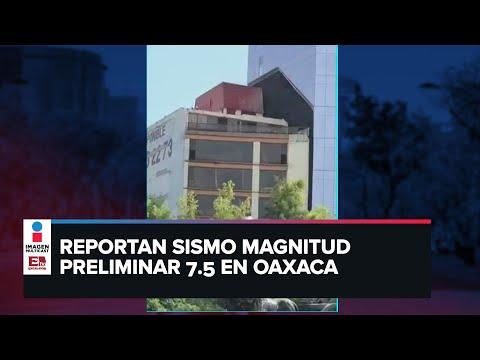 Momento en que dos edificios chocan entre sí durante sismo