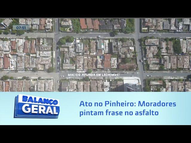 Ato no Pinheiro: Moradores pintam frase no asfalto