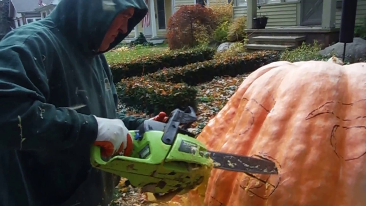 Worlds largest jack o lantern carved with a chainsaw youtube