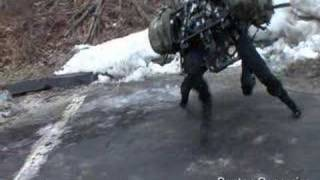 Boston Dynamics Big Dog (new video March 2008)(Boston Dynamics just released a new video of the Big Dog on ice and snow, and also demoing its walking gait., 2008-03-17T11:10:22.000Z)