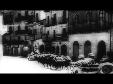 United States 7th Army troops advance through Sicilian villages HD Stock Footage