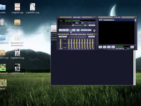 Linux Music Player Audarious with a Winamp skin and Status Icon plugin running on Xfce Desktop