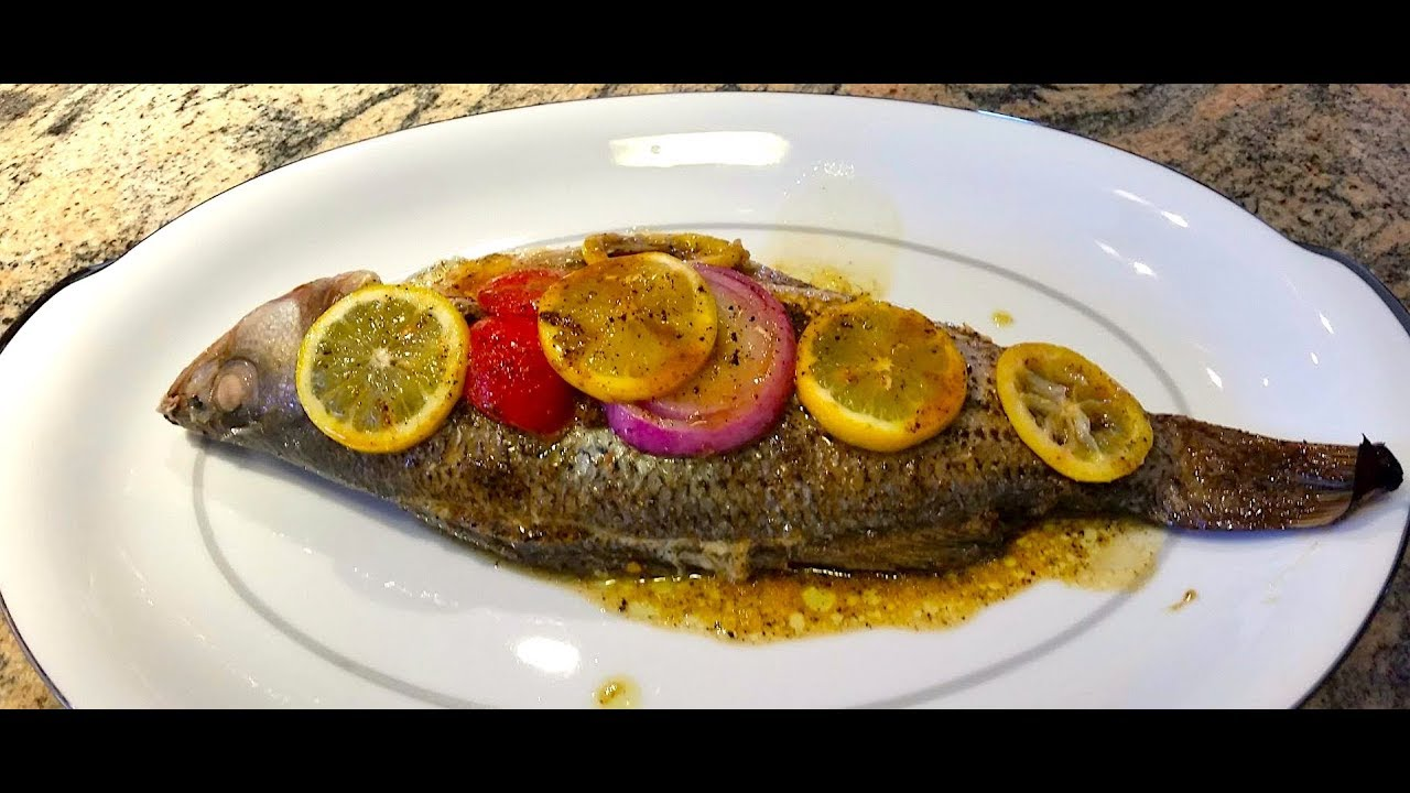 Oven baked striped bass oven roasted whole baked fish for Easy baked fish recipes