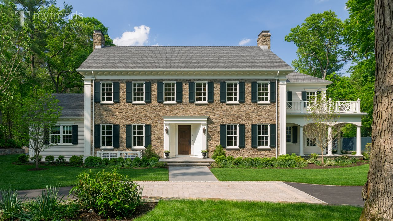 Traditional new england colonial house with woodlands for New england colonial style