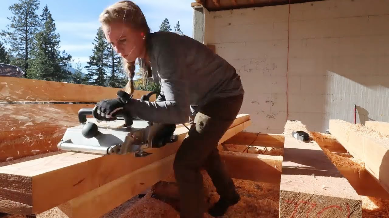 college-grad-shocks-her-parents-planing-timber-frame-beams