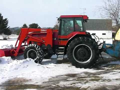 Case IH Magnum 7210 with CIH 710 loader performing snow/ice removal