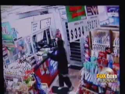 Armed Black Teenage Robber shot at by Vietnamese Store Clerk