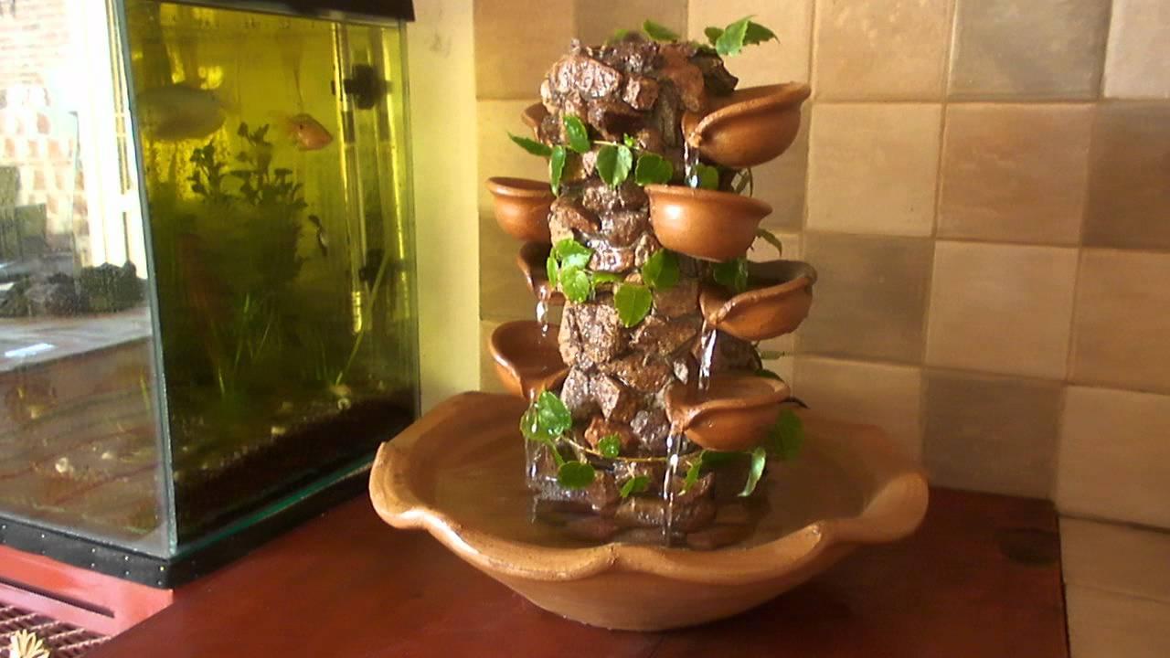 Fuente con piedras patagonicas y vasijas youtube for Jardines con piedras fotos