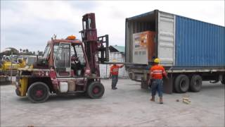 Heavy Equipment - Loading Denyo 220SP Generator Set into Container using Mitsubishi Forklift