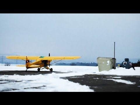 Checkout on Snow in the Piper Super Cub (PA18) (LSZI) with ATC