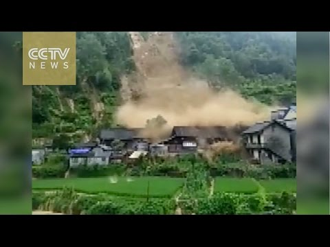 Watch: buildings collapse after heavy rainfall triggers landslide in Hunan Province
