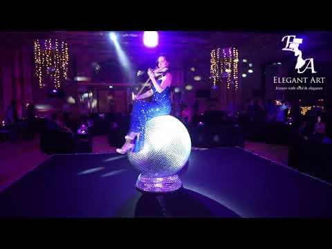 Mirror globe violinist in Dubai by Elegant Art Events, UAE