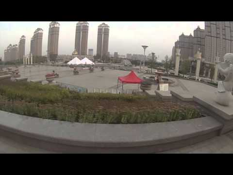 Biking in Harbin: Along the River, meeting with guy on mini-