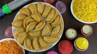 Homemade Indian sweet Gujiya rotating on a turntable for joyful Holi celebrations