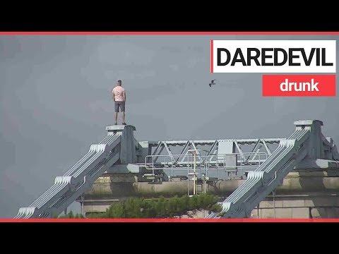 The Love Doctors - Drunk Dude Scales Bridge To Elude Cops