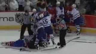 Alexei Kovalev elbows and fights Darcy Tucker