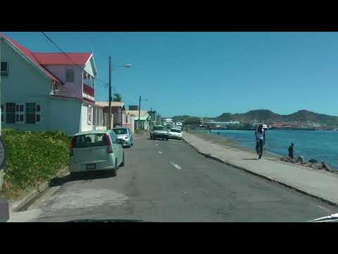 driving along the harbor in Basseterre, St. Kitts in a narrated tour bus
